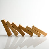 Domino effect - row of white dominoes on white background — Stockfoto