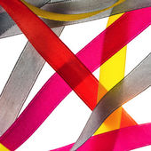 Red, yellow, orange, blue shiny gradient curling ribbons for design. — Stock Photo