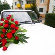 Stock Photo: Vintage wedding car decorated with roses.