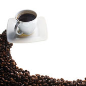 Kaffekopp och korn på vit bakgrund — Stockfoto