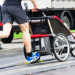 Stock Photo: Father run with baby stroller in marathon