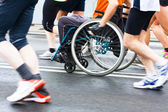 Disabled athlete in a sport wheelchair — Stock Photo