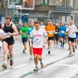 KRAKOW, POLAND - APRIL 28 : Cracovia Marathon. Runners on the city streets on April 28, 2013 in Krakow, POLAND  — Stock Photo
