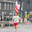 KRAKOW, POLAND - APRIL 28 : CracoviMarathon. Barefoot runner on city streets on April 28, 2013 in Krakow, POLAND — Stock Photo #25099779