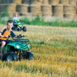 Stock Photo: Boy riding quad bike