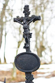 Marble cross on tomb at winter — Stock Photo