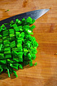Chives on a wooden surface — Stock Photo