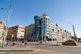 PRAGUE - AUGUST 20: Modern building, also known as the Dancing House, designed by Vlado Milunic and Frank O. Gehry stands on the Rasinovo Nabrezi. Photographed on AUGUST 20, 2011 in Prague. — Stock Photo