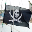 Flag of a Pirate skull and crossbones — Stock Photo