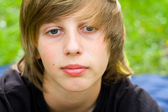 European school-age boy with blue eyes looking directly at the camera, close-up — Stock Photo