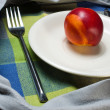 Red ripe nectarine peaches on white plate — Stock Photo