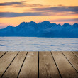 Landscape winter hill scene with fog and empty wooden deck table. — Stock Photo
