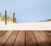 Beach and empty wooden deck table. Ready for product montage display. — Stock Photo