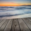 Sunset and empty wooden deck table. — Stock Photo #32925321