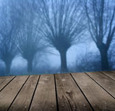 Dark atmosphere and empty wooden deck table. Ready for product montage display. — Stock Photo