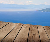 View from the terraces and empty wooden deck table. — Stock Photo