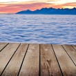 Landscape winter hill scene with fog and empty wooden deck table — Stock Photo