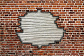 Brick wall with hole and wooden board — Stock Photo