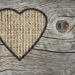 Background with a hole in the shape of heart and old wood board — Foto de Stock