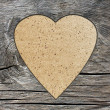 Background with a hole in the shape of heart and old wood board — Foto Stock