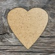 Background with a hole in the shape of heart and old wood board — ストック写真