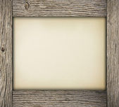 Wood frame with paper — Stock Photo
