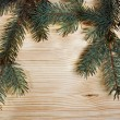 Christmas fir tree with decoration on a wooden board — Stock Photo #35280679