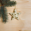 Christmas fir tree with decoration on a wooden board — Stock Photo #35280713