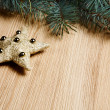 Christmas fir tree with decoration on a wooden board — Stock Photo #35451423