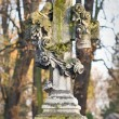 Cross with crucified Jesus Christ at cemetery — Stock Photo