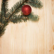 Christmas fir tree with decoration on a wooden board — Stock Photo #35451481