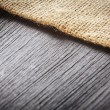 Burlap texture on wooden table background — Foto Stock