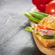 A fresh deli sandwich with ham, radish, tomatoes — Stock Photo