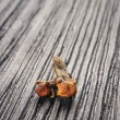 Pile cloves on wood background  — Stock Photo