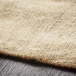Burlap texture on wooden table background — Stock Photo