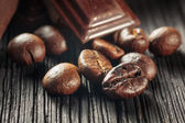 Close up of chocolate and coffee beans, shallow dof — Stock Photo