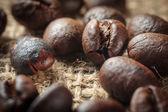 Coffee on grunge burlap background — Stock Photo