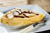 Crepe with whipped cream and chocolate sauce — Stock Photo