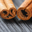 Stock Photo: Cinnamon on wooden background