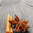 Stock Photo: Cinnamon and anise on wooden background