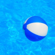 Colorful inflatable ball and round tube floating in swimming pool — Stock Photo
