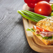 Stock Photo: Fresh deli sandwich with ham, radish, tomatoes