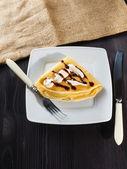 Sweet pancake with chocolate sauce and yogurt — Stock Photo