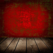 Old room with red wall and wooden floor — Stock Photo