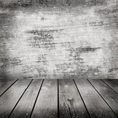 Room with grunge cement wall — Stock Photo