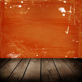 Old room with orange scratch wall — Stock Photo
