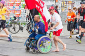 KRAKOW, POLAND - MAY 28 : Cracovia Marathon. Unidentified handicapped man in  marathon on a wheelchair on the city streets on May 18, 2014 in Krakow, POLAND  — Stock fotografie