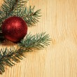 Christmas fir tree with decoration on a wooden board — Stock Photo #48130629