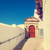 Vintage photo of narrow street in Lindos. Rhodes, Greece — Stock Photo