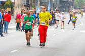 KRAKOW, POLAND - MAY 18 : Cracovia Marathon. Runners on the city streets on May 18, 2014 in Krakow, POLAND  — Stock Photo